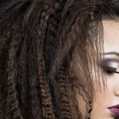 Torna di moda il frisè, i capelli mossi in stile afro!